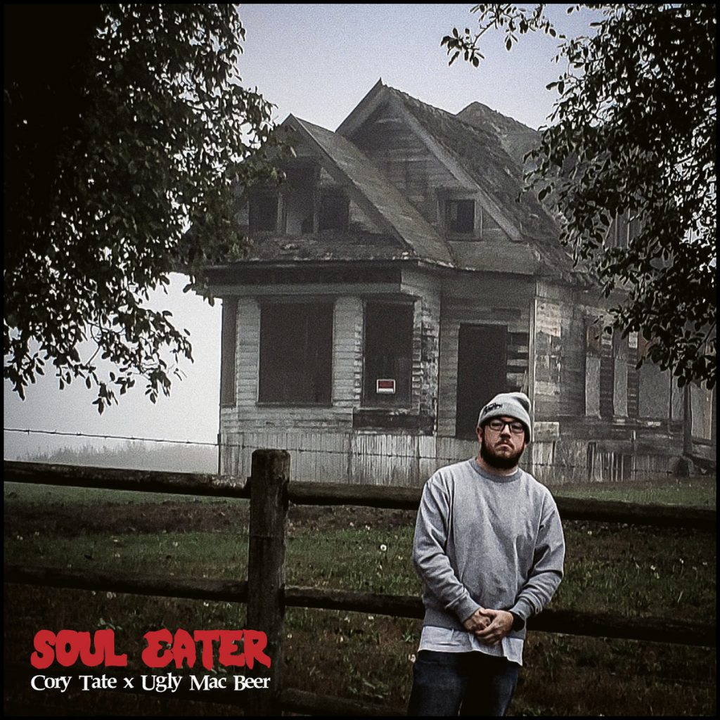 "Cover of ""Soul Eater"", the single from Cory Tate features the MC standing outside of a creepy looking, abandoned white house."
