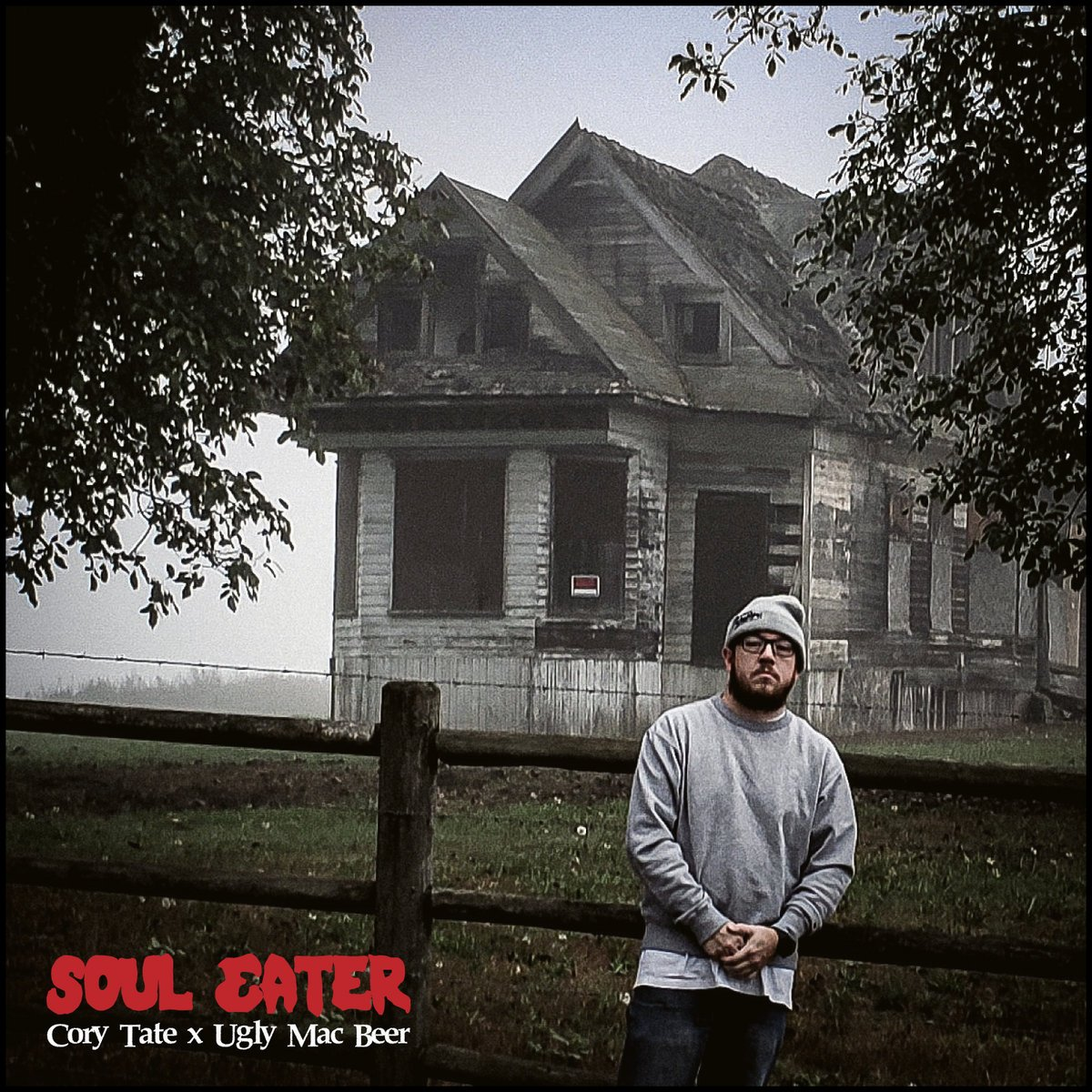 """Cover of """"Soul Eater"""", the single from Cory Tate features the MC standing outside of a creepy looking, abandoned white house."""