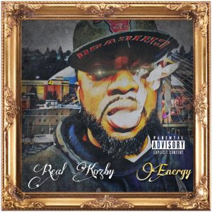 """On the cover for Real Kozby's """"Energy"""", the rapper is pictured blowing smoke out while standing in front of the Tacoma Dome."""