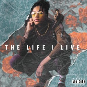 """Yel has a new EP """"The Life I Live"""" and on the cover she is seen squatting while listening to a cell phone."""