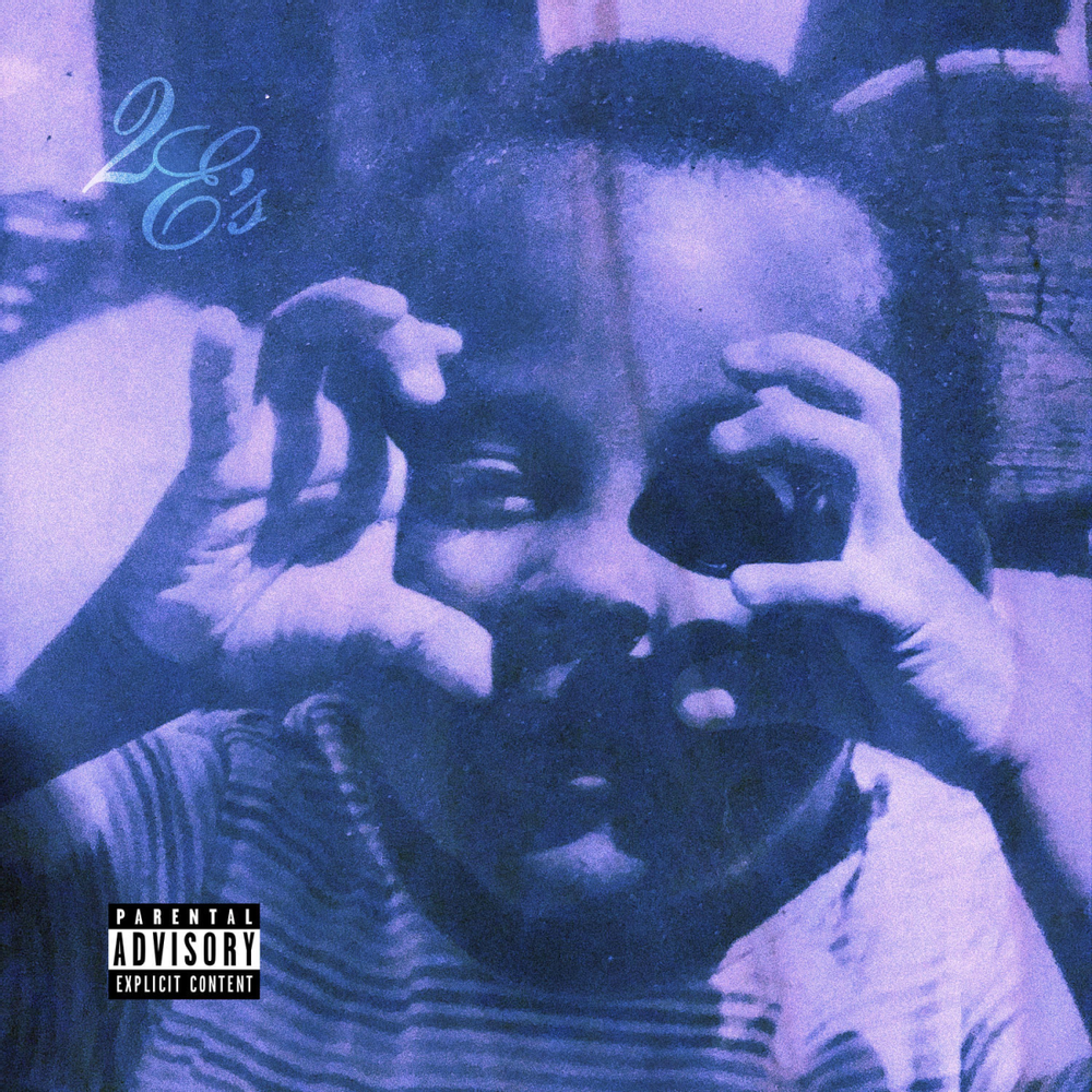 "Cover for Big Matloc ""Two E's"" features a child making two e's with his hands."