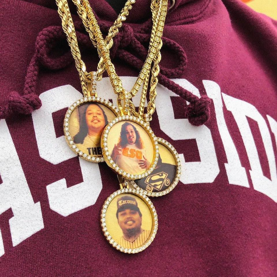 Close up of gold chains with various pictures and of ESO FT's friends.