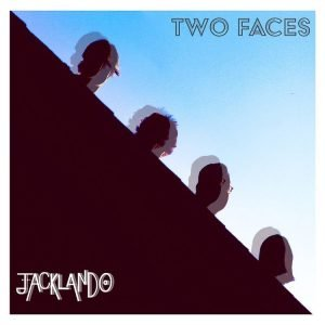"""Cover for Jacklando's """"Two Faces"""" EP features a blurry, silhouetted shot of the group's heads sticking out from behind a shadowy surface."""