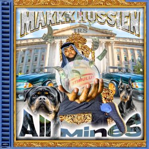 """Makkk Hussien has a new single """"All Mines"""" and on the cover he is wearing Arabic attire while standing in front of the IRS building with two dogs on his side."""
