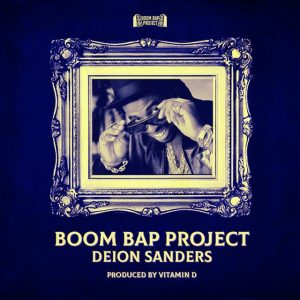 """Cover for Boom Bap Project single """"Deion Sanders"""" has an image of Deion taking off his sunglasses."""