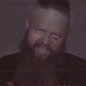 """BARZ! gives a menacing smile in this still shot from his video """"Day Nones""""."""