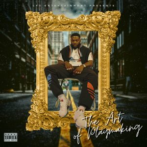 """Lroc sits in the middle of a city street while framed in a giant golden frame on the cover to """"The Art of Playmaking""""."""